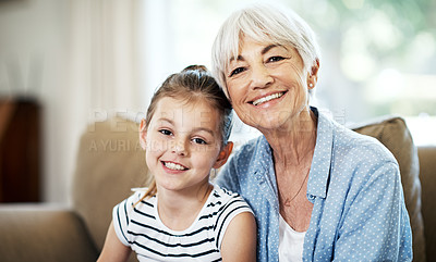 Buy stock photo Portrait of an adorable little girl spending time with her grandmother at home