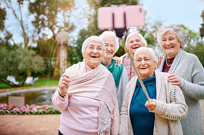 Buy stock photo Cropped shot of a group of seniors taking a selfie