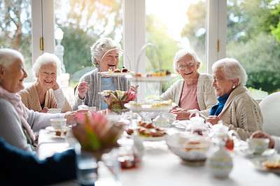 Buy stock photo Cropped shot of a group of seniors having tea in their retirement home