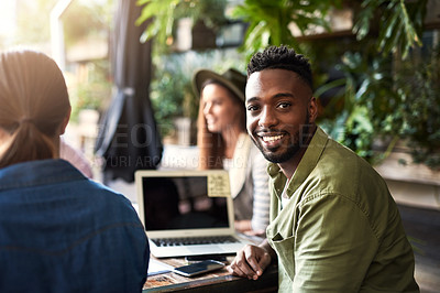 Buy stock photo Portrait of a young designer having a meeting with his colleagues at a coffee shop