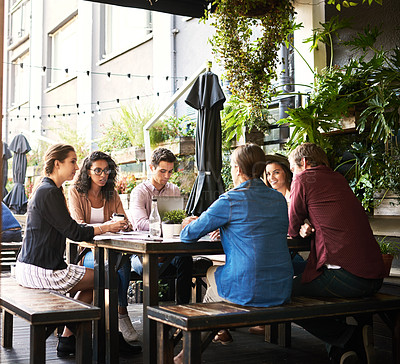 Buy stock photo Shot of a group of designers having a meeting at a coffee shop