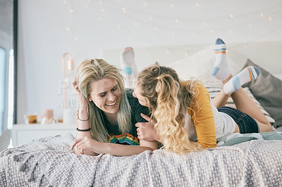 Buy stock photo Shot of two young friends spending time together at home