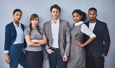 Buy stock photo Cropped portrait of a group of young businesspeople waiting in line for their interviews