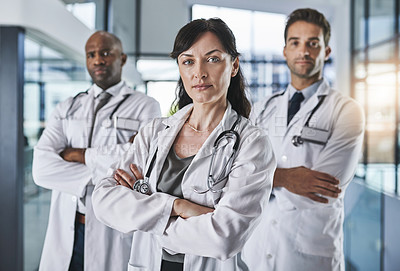 Buy stock photo Portrait of a team of confident doctors standing together in a hospital