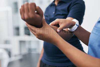 Buy stock photo Closeup shot of a physiotherapist assessing a patient in a rehabilitation center
