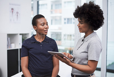 Buy stock photo Shot of a physiotherapist consulting with a patient in her office
