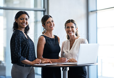 Buy stock photo Portrait of a group of businesswomen working together in an office