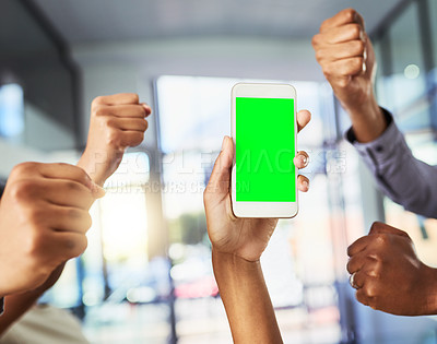 Buy stock photo Closeup shot of an unrecognizable group of businesspeople cheering to a cellphone with a green screen in an office