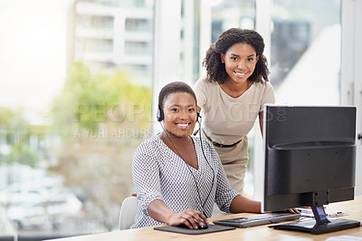 Buy stock photo Portrait of two businesswomen working in a call centre