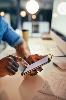 Buy stock photo Cropped shot of an unrecognizable businessman using a cellphone while working late in the office