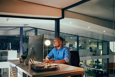 Buy stock photo Shot of a man working late in an office