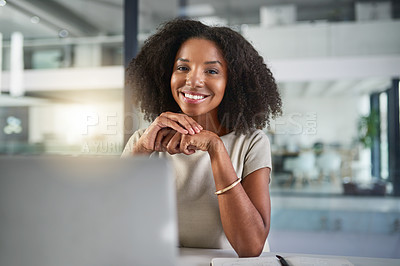 Buy stock photo Cropped portrait of an attractive young businesswoman working on a laptop in her office