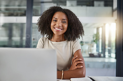 Buy stock photo Cropped portrait of an attractive young businesswoman sitting with her arms folded at her desk