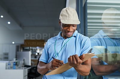 Buy stock photo Shot of a confident young delivery man holding a clipboard in an office