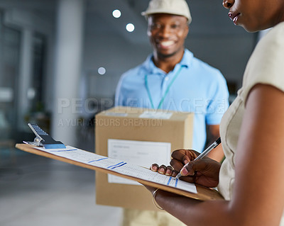 Buy stock photo Cropped shot of a young woman signing for her delivery from the courier in an office