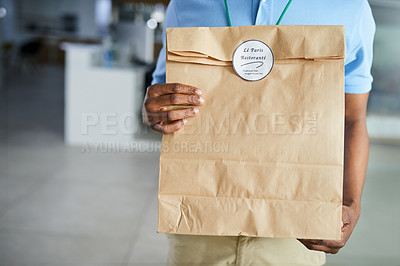 Buy stock photo Cropped shot of a man delivering an order of fast food to an office