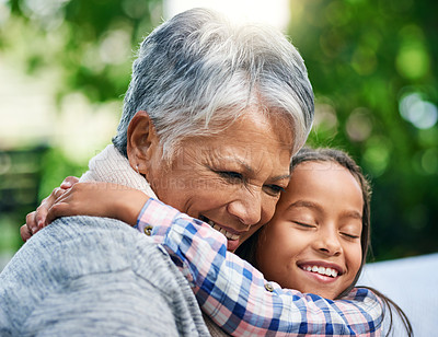 Buy stock photo Cropped shot of an adorable little girl enjoying the day outdoors with her grandmother