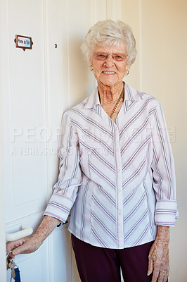 Buy stock photo Portrait of an elderly woman putting keys into the door at home