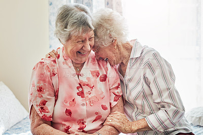 Buy stock photo Shot of two happy elderly women spending time with each other at home
