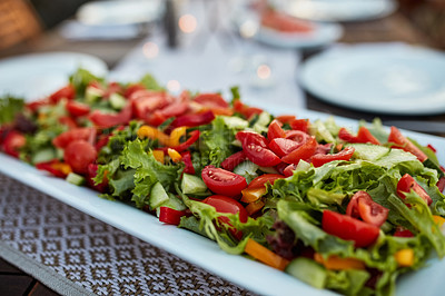 Buy stock photo Still life shot of a plate of salad on a table outdoors