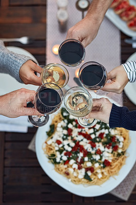 Buy stock photo Closeup shot of a group of friends making a toast while enjoying a meal together outdoors