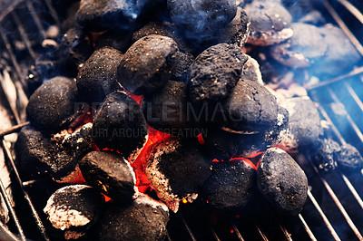 Buy stock photo Cropped shot of coals on the barbecue outside