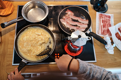 Buy stock photo High angle shot of an unrecognizable woman cooking breakfast in the kitchen