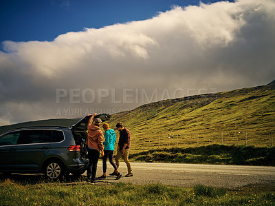 Buy stock photo Shot of a group of friends packing up their car to go home after a great day of hiking in nature