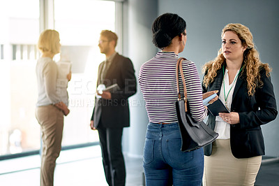 Buy stock photo Shot of businesswomen having a discussion at a convention center