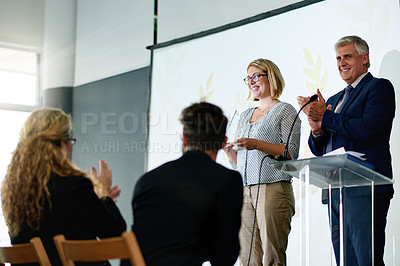 Buy stock photo Shot of a young businesswoman being awarded a prize during an awards giving ceremony at a conference