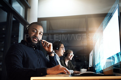 Buy stock photo Cropped portrait of a male IT support staff member working the late shift with his team in their office