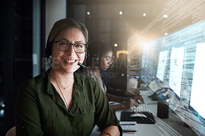Buy stock photo Cropped shot of a female IT support staff member working the late shift with her team in their office