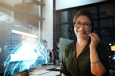 Buy stock photo Cropped shot of a female IT support staff member working the late shift in the office