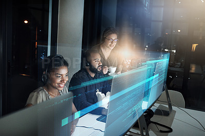 Buy stock photo High angle shot of an IT support team working the late shift in their office