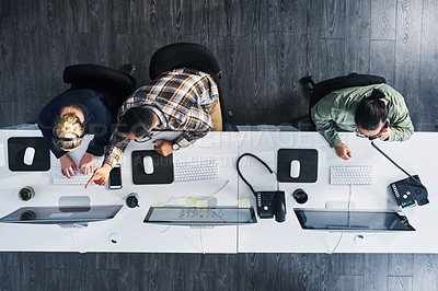Buy stock photo High angle shot of a group of call centre agents working in an office