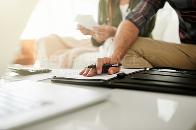 Buy stock photo Closeup shot of a couple managing their budget together at home