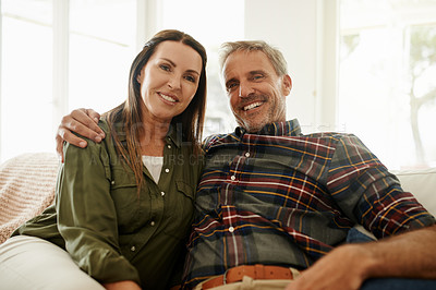 Buy stock photo Shot of a mature couple relaxing together at home