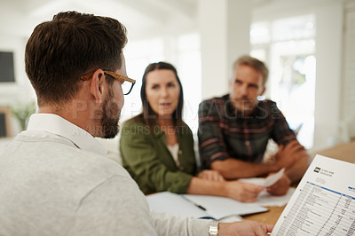 Buy stock photo Shot of a consultant meeting with clients at their home