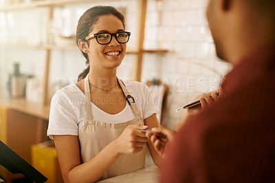 Buy stock photo Cropped shot of a young woman accepting a card payment