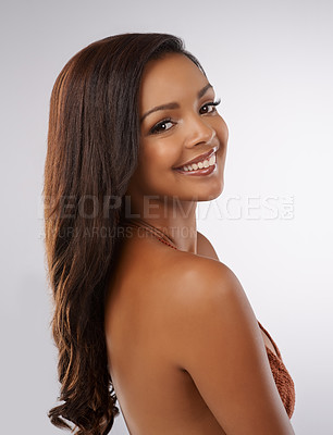 Buy stock photo Studio portrait of a beautiful young woman in a bikini against a gray background