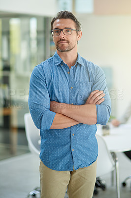 Buy stock photo Cropped shot of a confident businessman in an office