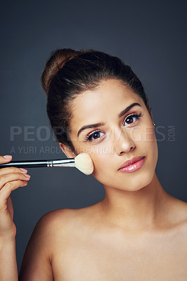 Buy stock photo Studio shot of a beautiful young woman posing against a dark background
