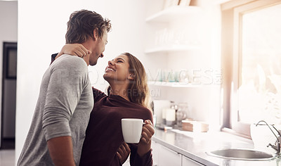 Buy stock photo Shot of an affectionate young couple having a coffee break at home