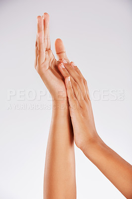 Buy stock photo Studio shot of an unrecognizable young woman's hands against a gray background