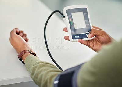Buy stock photo Closeup shot of an unrecognizable man checking his blood pressure