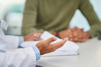 Buy stock photo Closeup shot of a doctor having a consultation with a patient in his office