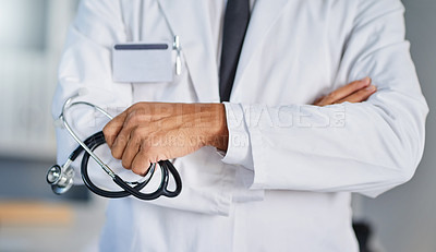 Buy stock photo Closeup shot of an unrecognizable doctor holding a stethoscope in a hospital