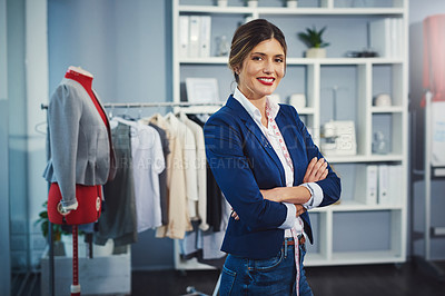 Buy stock photo Cropped portrait of an attractive young fashion designer standing with her arms crossed in her workshop