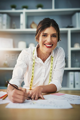 Buy stock photo Cropped portrait of an attractive young fashion designer working on her designs in her workshop