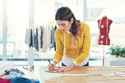 Buy stock photo Cropped shot of an attractive young fashion designer in her workshop